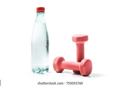 Training weights isolated on white background. Weight training equipment: dumbbells, bottle of water.