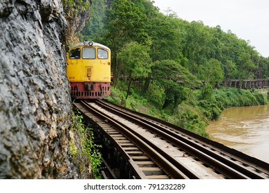 Trains run through the middle of the mountains and river rapids, The place is located in Thailand, Kanchanaburi Called Tham Krasae, Beautiful nature, Railroad tracks, copy space.