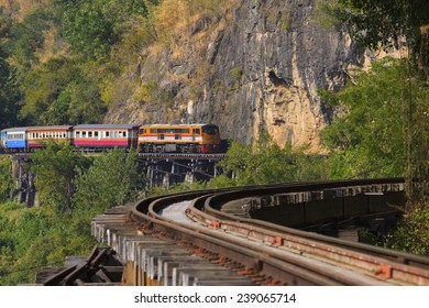 trains running on death railways crossing kwai river in kanchanaburi border of thailand-myanmar important landmark and destination to visiting and world war II history builted by soldier prisoner