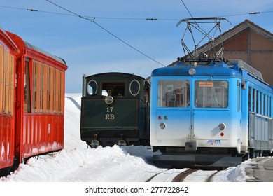 Trains used by the Rigi railways (German: Rigi-Bahnen). On the right hand side is the Arth-Rigi railway, on the left side the Vitznau-Rigi railway and in the middle the historic steam railway.