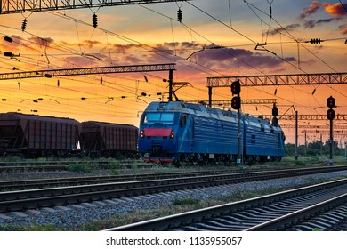 trains and wagons, railroad infrastructure, beautiful sunset and colorful sky, transportation and industrial concept
