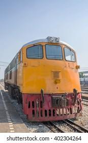 Trains waits at a platform of railway