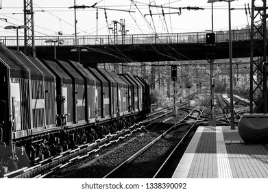 Trainstation in black an white with a leaving train
