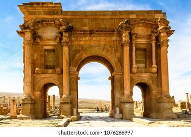 Trajan's Arch of Timgad, a Roman-Berber city in the Aures Mountains of Algeria. (Colonia Marciana Ulpia Traiana Thamugadi). UNESCO World Heritage Site