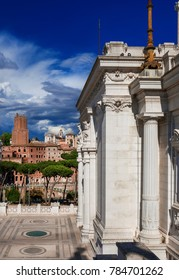 Trajan's Market ancient roman ruins with the old Tower of the Militia and clouds seen from Altar of Nation monumental terrace in the historic center of Rome