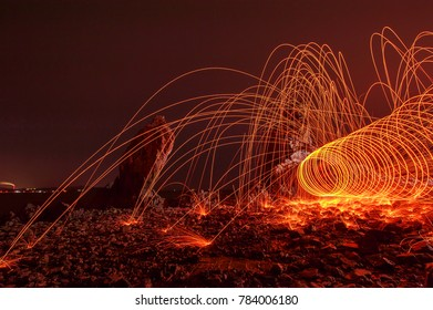 Trajectories of burning sparks