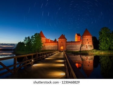 Trakai castle medieval gothic Island castle, located in Galve lake. Flat lay of the most beautiful Lithuanian landmark. Long Exposure Star Trail in Lithuania