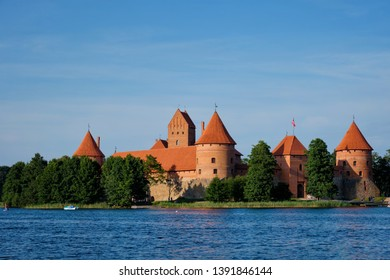 Trakai Island Castle in lake Galve with boats in summer day, Lithuania. Trakai Castle is one of major tourist attractions of Lituania