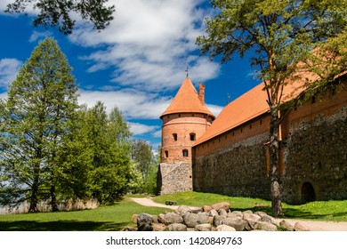Trakai Island Castle in Lithuania, Eastern Europe. Tourists visit city castle. Famous ancient landmark.