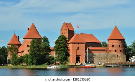 The Trakai island castle is located on an island in lake Galve on sunny summer day in Trakai, Lithuania.