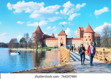 Trakai, Lithuania - April 2, 2017: Young couple at Trakai island castle at Galve lake, near Vilnius, Lithuania