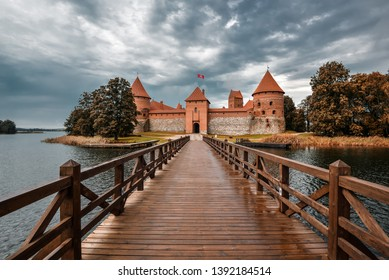 Trakai, Lithuania - August 15, 2017: Landscape of Trakai Island Castle, lake and wooden bridge, Lithuania. Trakai Island Castle and bright blue dramatic sky with clouds.