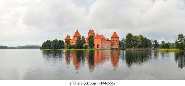 Trakai, Lithuania - August 15, 2017: Beautiful landscape of Trakai Island Castle,  Lithuania. Trakai Island Castle panorama, lake and forest. Reflection of the Trakai castle in the water of the lake