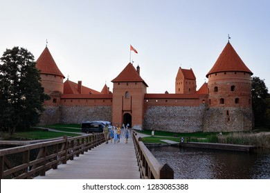 Trakai, Lithuania - August 4, 2018: People at Trakai Castle on the Galve Lake in Trakai in Lithuania in the evening.