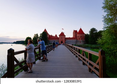 Trakai, Lithuania - August 4, 2018: People at Trakai Castle on the Galve Lake in Trakai of Lithuania in the evening.