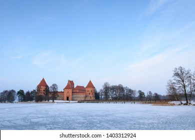 Trakai, Lithuania, February 8, 2019 Trakai medieval castle in winter in the middle of frozen lake, red brick castle fortress, Christianity tourism, old beautiful architecture outdoors with snow nature