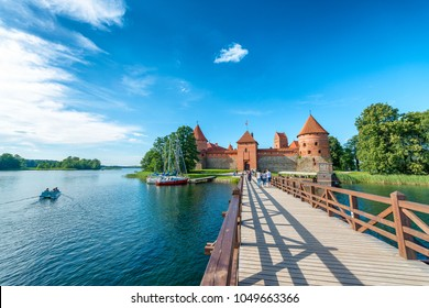 TRAKAI, LITHUANIA - JULY 10, 2017: Tourists visit city castle. This is a major attraction in Lithuania.