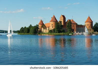 TRAKAI, LITHUANIA - JULY 17, 2009: View to the Trakai castle and Galve lake with boats in Trakai, Lithuania.