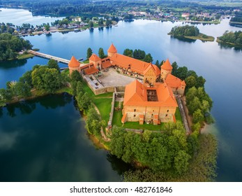 Trakai, Lithuania: medieval gothic Island castle, located in Galve lake and town in the background. Aerial above summer UAV top view, flat lay of the most beautiful Lithuanian landmark.