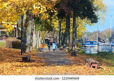 Trakai, Vilnius / Lithuania - October 22 2018: People walking and relaxing in the beautiful village of Trakai, Vilnius, Lithuania, Autumn background