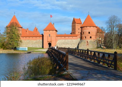 Trakai, Vilnius / Lithuania - October 22 2018: Medieval castle of Trakai, Vilnius, Lithuania, Eastern Europe, located between beautiful lakes and nature with wooden bridge