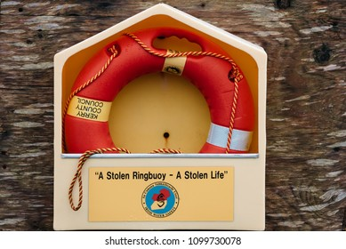 Tralee, Ireland - November 11, 2017: Life buoy hanging on wall for emergency response in harbor