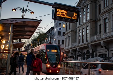 Tram approaching Istanbul's touristic Sultanahmet station, passengers standing, April 13, 2018