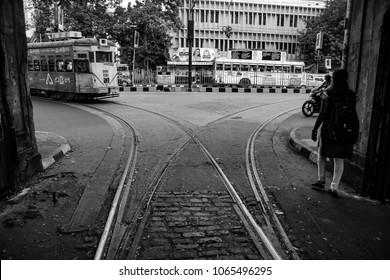 tram approaching in a tram track junction depot in street of kolkata, black and white, Kolkata, India, 2017