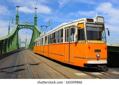 Tram coming from Freedom bridge, Budapest, Hungary