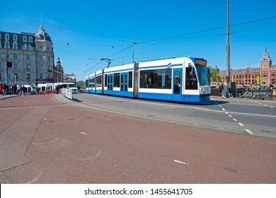 Tram driving in the city center from Amsterdam in the Netherlands with the central station