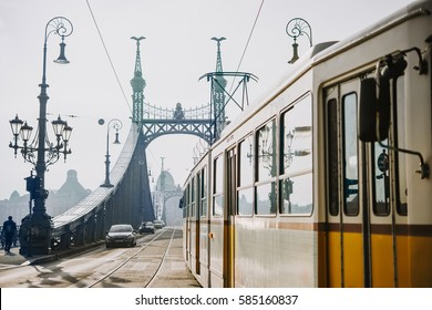 A tram entering Liberty bridge in Budapest, Hungary. Toned picture