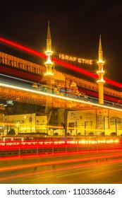 Tram lights and vehicle lights on Galata Bridge.Long Exposure. Mahya lamps in Renovated Mosque minaret.Write;Do not waste/ Eminonu,Istanbul,Turkey,31 May 2018