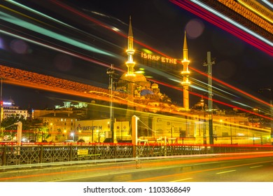 Tram lights and vehicle lights on Galata Bridge.Long Exposure. Mahya lamps in Renovated Mosque minaret.Write;Do not waste/ Eminonu,Istanbul,Turkey,31 May 2018