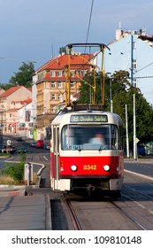 The tram moves on rails down the street Prague