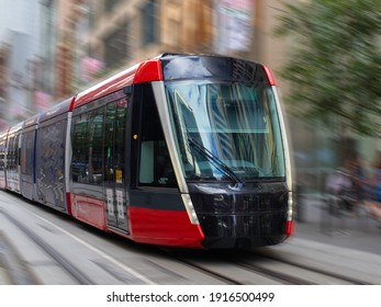 Tram moving through George St in Sydney NSW Australia