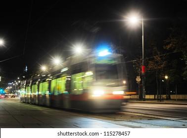 Tram at night on the street of Vienna, Austria. Long exposure