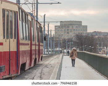 tram on a bridge in winter close-up