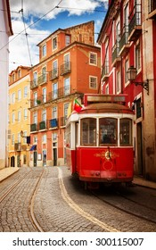 tram on narrow street of Alfama, Lisbon, Portugal, retro toned