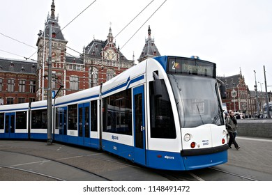 Tram on its way in central street of Amsterdam in Netherlands on March 13, 2017