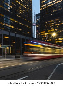 A tram passes through the financial district of downtown Toronto, Canada early in the morning.