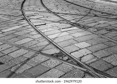Tram railroad switch at an intersection in Milan city centre, Italy. Tram is a traditional public transportation mean in the city.