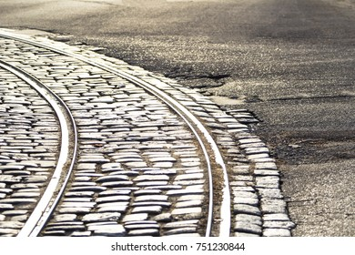 tram rails in paving stones in the middle of the road