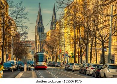 Tram in scenic street Prague Sunset Namesti miru Vinohrady 31 March 2019