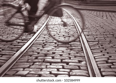 Tram track in Ghent, Belgium with cyclist