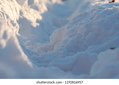Trampled Path in the Snow at Sunset, Close-up