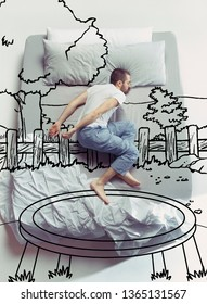 Trampoline jumping. Top view photo of young man sleeping in a big white bed at home. Dreams concept. Painted dream about summertime, vibes, nature, activity, sport, trees, weekend, resort, holidays.