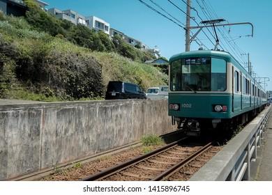 Trams run through communities in the province.  kamakura, japan, May22,2019