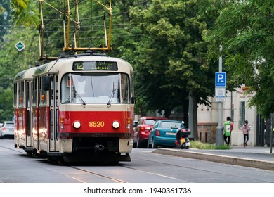 """Tramway T3 in Prague street. Old Czech red tram number 12 in Prague. Vintage public transport in the capital of the Czech republic. Translation: """"Smichov railway station"""" - Shutterstock ID 1940361736"""