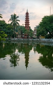 Tran Quoc Buddhist Pagoda in Hanoi, Vietnam at Sunset with Colorful Clouds