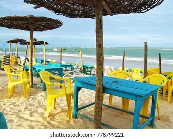 Trancoso, Brazil - April 9, 2010: Partial view of Praia dos Coqueiros beach in Trancoso, with its colorful tables and chairs waiting for tourists to enjoy the wide variety of local dishes and drinks.